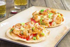 We zien ze steeds vaker: pizza's met een bodem van tortilla. Ze worden ook wel tortizza's genoemd.