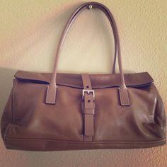 Prada handbag 100% authentic Prada genuine soft lamb skin vintage handbag.  Includes original dust bag and tags. In good condition! Prada Bags