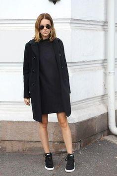 Women's Black Sunglasses, Black Sweater Dress, Black Coat, and Black Low Top Sneakers