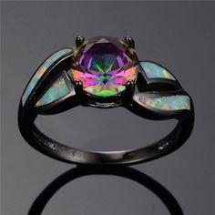 White Fire Opal Ring https://www.gecqo.com/collections/opals/products/white-fire-opal-ring