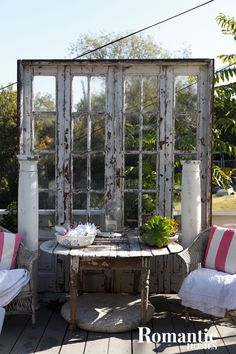 Saved and now chic: french doors, table, pedestals, and wicker.