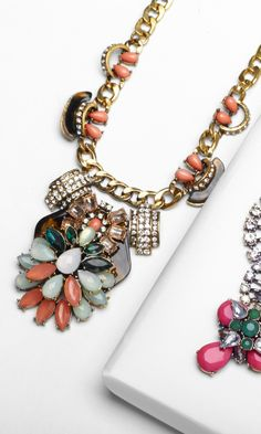 This  necklace would turn a neutral colored simple top into  a small work of art.