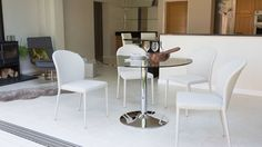 White Dining Chairs and Glass Dining Table