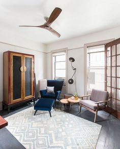 Musical and Moroccan Influences in an NYC Apartment – Homepolish Blue Armchair, Antique Cabinets, New Furniture, Old And New, Home Accessories, Lounge, House Design, Living Room, Interior Design