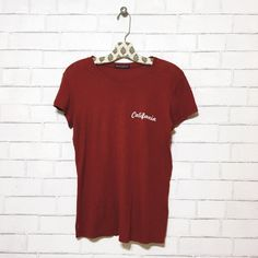 Brandy Melville California Tee Brandy Melville California Tee Shirt in brick red * Size: One Size fits most Brandy Melville Tops Tees - Short Sleeve