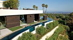 Moats are the newest security feature in LA. Wraparound Water Features and house designed by architect Michael Palumbo.