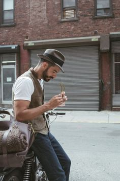 Fedora, waistcoat with a pocket watch and a vintage motorbike.