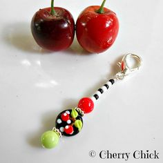 https://flic.kr/p/GiZYWU | Scissor Fob - Scissor Minder - Zipper Charm - Beaded fob - Purse Charm | Cherry scissor fob.....Just what every stylish pair of scissors needs...an Artisan handcrafted beaded fob. This charming little accessory measures just a hair short of 3 inches in length and will easily attach to the scissors handle securely with a lobster claw hook. The whimsical glass lampwork bead is 14mm around and is adorned with bright red Cherries. Finishing off the design are red and a...