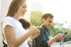 Friends using smartphones outdoors together and chilling   premium image by rawpixel.com