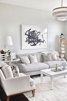 A living room makeover with Rugs USA's Alabaster Cow Hide Patchwork II Rug! So stunning!