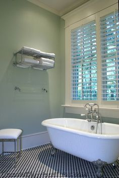 Floating shelves and more traditional items. Nice. Classic double ended bathroom traditional bathtubs
