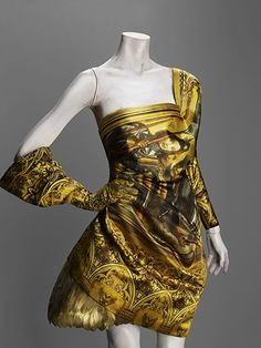 Ensemble by Alexander McQueen, Autumn/winter 2010- 11: Made of silk and gold painted duck feathers. #Alexander_McQueen #Dress
