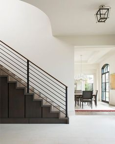Clean, bright and minimalist, the stunning foyer sets the tone for this contemporary home. The metal stair railing helps keep the space feeling open and breezy.