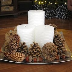 Make a beautiful natural centerpiece for your holiday table in just minutes- orange candles instead of white.