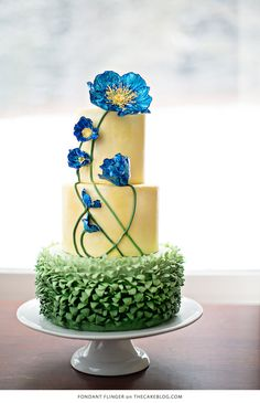 So many pretty cakes here but I love the blue poppies on this one Cake Wrecks - Home - Sunday Sweets: I'm Your Maître D' Fancy Cakes, Cute Cakes, Pretty Cakes, Cake Wrecks, Bolo Floral, Floral Cake, Tulip Cake, Gorgeous Cakes, Amazing Cakes