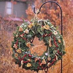 Must make this for the cemetery this year. beautiful wreath that also feeds the birds!