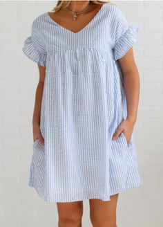 Go play on la playa in this adorable seersucker dress. It features a v neck with ruffle sleeves and a smocked bust. It also has pockets, perfect for collecting seashells! Wear is with sandals, wedges, or barefeet.. depending on your location! ;)