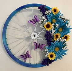 Floral butterfly bicycle wheel wreath for spring; Just Jenn Home Arts.