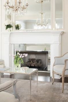 Leo Designs Chicago - living rooms - French living room, inset mirror, fireplace mirror, mirror fireplace surround, mirrored fireplace surround