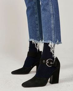 Layer frayed denim jeans over sock ankle boots | They All Hate Us