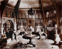 Andrew McNally's Egyptian room, pictured here in a photo that dates to 1898. Writes Watters of the octagonal room: Pierced screens and ogee arches along the walls glowed in shades of tangerine, gold and azure blue. Colored glass in a brass lantern shimmered, illuminating decorations essential to every fashionable Oriental parlor: a hookah pipe, inlaid ivory tables, stools and a recessed, embroidered banquette.