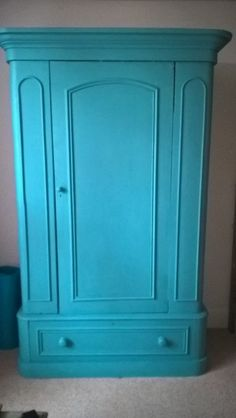 Beautiful Victorian wardrobe painted in turquoise. Solid pine with deep bottom drawer and metal hang