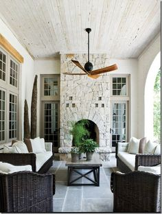 Outdoor fireplace on a porch.