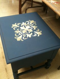 Napleonic Blue Chalk Paint (tm) painted end table with Old White and Cream stencil.  Budget ReDesign LLC.
