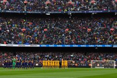 FC Barcelona and Atletico de Madrid players observe a minute of silence in memory of FC Barcelona player Quini during the La Liga match between Barcelona and Atletico Madrid at Camp Nou on March 4, 2018 in Barcelona.