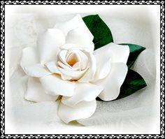 Gardenia pin or hair clip.  Find it at: http://www.zhibit.org/faelass/flower-sculptures/gardenia