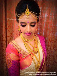 Love the interplay of colours on Ashwini for her muhurtam. Makeup and hairstyle by Vejetha for Swank Studio. Photo credit: Manish Ananda. Berry lips. Smokey eye makeup. Maang tikka. Bridal jewelry. Bridal hair. Silk sari. Bridal Saree Blouse Design. Indian Bridal Makeup. Indian Bride. Gold Jewellery. Statement Blouse. Tamil bride. Telugu bride. Kannada bride. Hindu bride. Malayalee bride. Find us at https://www.facebook.com/SwankStudioBangalore