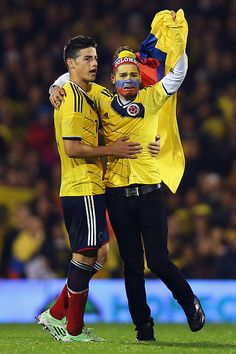 A Colombia fan runs onto the ptich to greet Captain James Rodriguez during the International Friendly between the USA and Colombia at Craven Cottage on November 14, 2014 in London, England.
