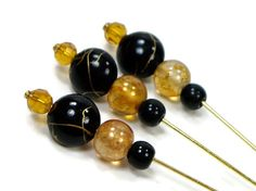 This set of 3 black and gold beaded counting and marking pins is a must for anyone who does counted needlepoint or other canvas work. They are longer $9.00