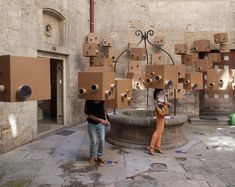 cite surprise, cite surprenante' by tri-oh! ateliers, madrid/ paris      the hanging boxes provide users with specific glances of the surrounding environment in a metaphorical representation of societal criticisms  of urban architecture.