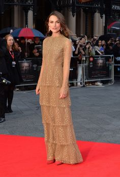 Keira Knightley wowed us with this look from the opening night gala screening of The Imitation Game during the 58th BFI London Film Festival in London, England.Knightley wore a nude gown with gold thread detail from the Fall 2014 Valentino collection. Originally, the dress featured a completely see-through construction—part of the sheer eveningwear trend we've spotted on runways and red carpets. Knightley had the dress lined, leaving only the sleeves sheer.The actress offset the elegance of ...