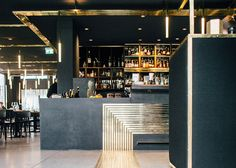 A path of narrow brass lines lead visitors the different areas of the restaurant in Munich, which is set inside a historical post-war building