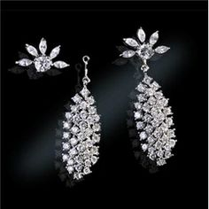 Jackie received these diamond Waterfall Drop Earrings from JFK in 1957 after the birth of their daughter, Caroline. The Waterfall Earrings are probably the most photographed piece of jewelry in the world. Jackie wore them to her most publicized affairs - from her trip to Paris as First Lady to her reception of countless international glitterati at the White House.  Caroline still keeps these earrings that were given to commemorate her birth and wears them to very special occasions.