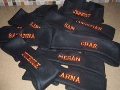 Custom made fleece ear warmers and headbands for varsity cheerleaders personalized with each members name.