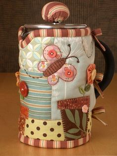 French Press Cozy. Bit obscure but perfect for a person who owns one. Besides I like the patchwork.