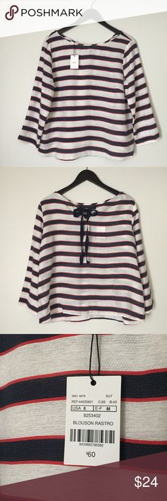 """MNG Red, White, & Blue Stripe Oversized Blouse New with tags! MNG Blouson Rastro Top! Size small / Size 6 - Runs Large. Has a navy blue bow on the back. Red, white, and blue!! Perfect for Memorial Day, Veterans Day, Independence Day (July 4th). Show off your patriotic side! Front is 23"""" long, back 21 1/2"""", 21"""" pit to pit, sleeves 12 1/2"""" long pit to hem. 82% viscose and 18% polyamide. Part of the MNG Suit Collection. Great condition! NO TRADES. MNG Tops Blouses"""