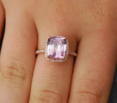 This ring features a 3.4ct cushion sapphire, SI. The stone is unbelievably   beautiful, clean and sparkling. It is a natural non-treated stone, very rare.  The color is pastel ice champagne peach with a hint of lilac, mauve blush. Very pretty!   This beauty is set in a 14k rose gold diamond setting