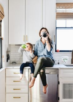 Mother And Son Discover 10 Time-Saving Mom Hacks That Will Streamline Your Life - Francois et Moi % % Mother drinking coffee daughter drinking hot chocolate from a sippy cup. Both sitting on kitchen counters by Erin Francois Mommy And Son, Mom Daughter, Mom And Baby, Mother Daughters, Mother Son Photos, Mama Baby, Foto Baby, Mom Hacks, Baby Pictures