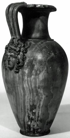 Alabaster jug; triple handle terminating in swan-head and two snake-heads at top and head of Medusa at base.
