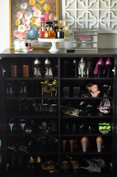Caitlin Wilson Design    Gorgeous bedroom shoe storage with espresso stained shoe shelves cabinet, white lattice screen, white pedestal fragrance tray and mirrored jewelry box.