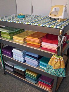 For my dream craft studio room.Top shelf is an ironing board! Extra storage for fabric, sewing notions, etc. No need to take out the ironing board each time. Sewing Room Organization, Craft Room Storage, Fabric Storage, Craft Rooms, Organizing, Storage Shelves, Storage Ideas, Craft Shelves, Metal Shelving