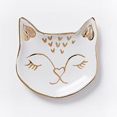 "Cat Ring Dish, White/Gold by: @West Elm At your bedside or atop a dresser, this pretty kitty is the perfect place to keep your rings, earrings and small jewelry. 4.1""""sq. x 0.75""""h. Glazed ceramic with Gold accents. Imported."