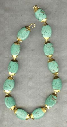 turquoise and 22k gold - handmade by Michele Delville.