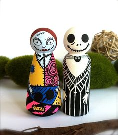 Jack and Sally Wedding Cake Toppers The Nightmare Before Christmas Wooden Wood Peg Dolls Hand Painted Anime Cartoon Style Whimsical Cute. $116.00, via Etsy.