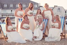 Bridesmaids in lemon coloured bridesmaids dresses on striped deck chairs onPhotography by one thousand words wedding photographers