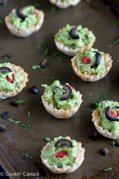 Mini Guacamole & Olive Cups Recipes...The kids love this healthy snack!   cookincanuck.com #vegetarian